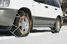 Car with snow chains fitted.