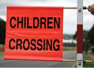 Red flag marked children crossing.