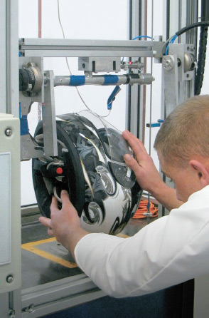 A technician testing a motorcycle helmet.