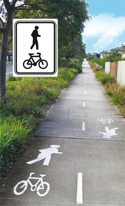 Shared paths are marked with signs that have graphics of a pedestrian at the top and a bicycle at the bottom.