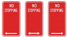 No Stopping signs are red with white text and white arrows.